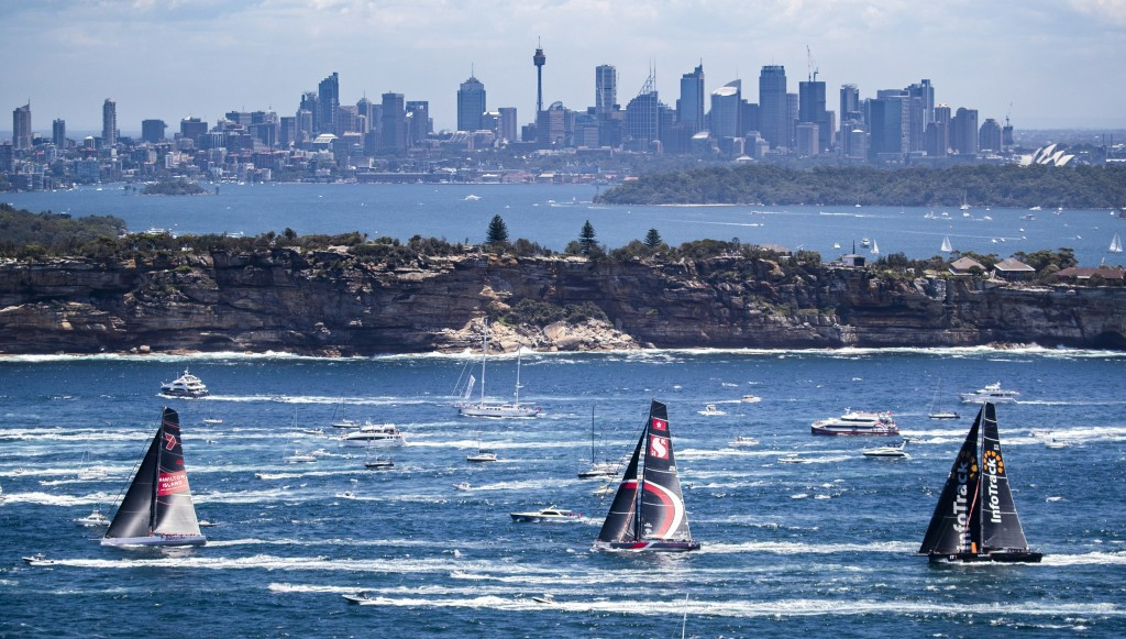 In this photo provided by Rolex/Studio Borlenghi, the 85-strong fleet of yachts begin the Sydney Hobart yacht race from Sydney Harbour, Wednesday, Dec...