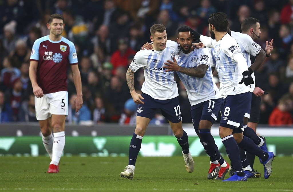 Everton's Lucas Digne, fourth right, celebrates scoring his side's second goal of the game with teammates during the English Premier League soccer mat
