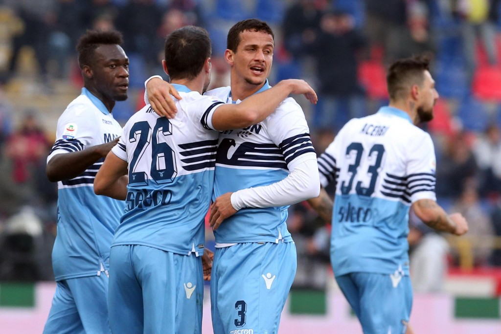 Lazio's Luiz Felipe, center, celebrates with his teammates after scoring during a Serie A soccer match between Bologna and Lazio in Bologna, Italy, We