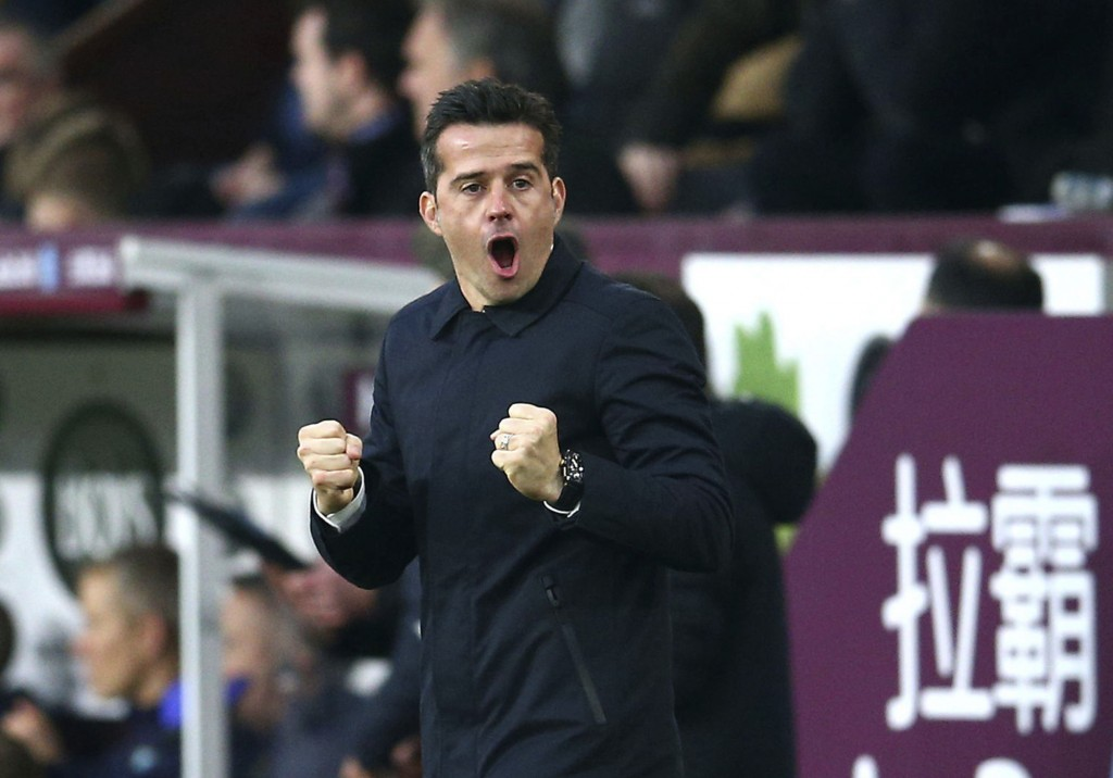 Everton manager Marco Silva celebrates Yerry Mina scoring his side's first goal of the game  during the English Premier League soccer match between Bu...