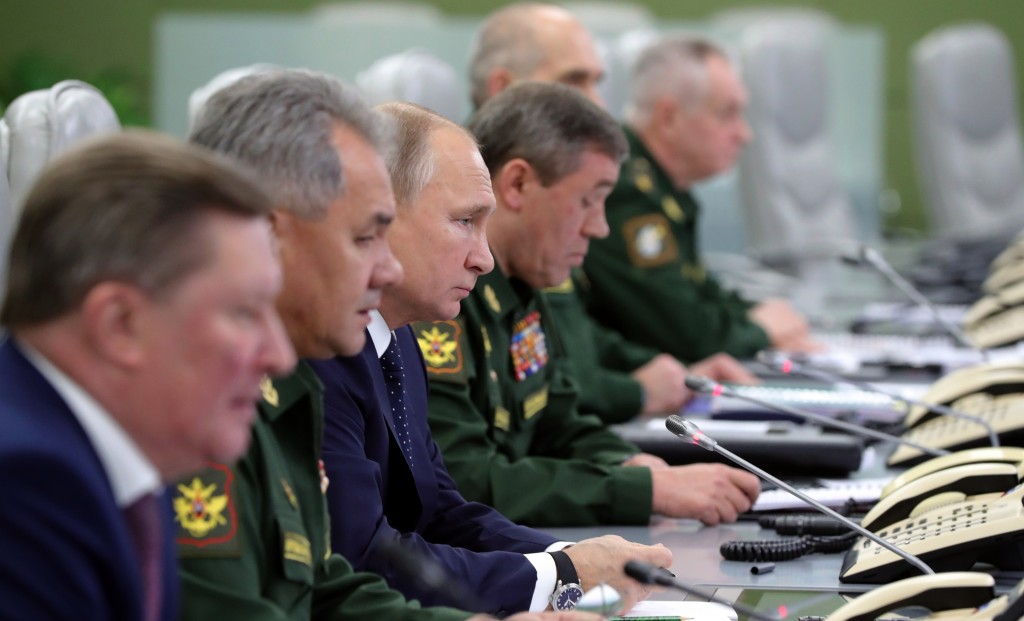 From the left, Sergei Ivanov, Russian special representative on questions of ecology and transport, Russian Defense Minister Sergei Shoigu, Russian Pr...