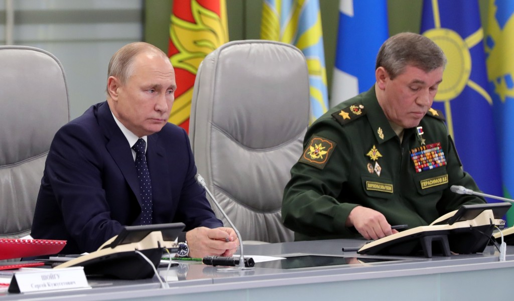 Russian President Vladimir Putin, left, and Chief of General Staff of Russia Valery Gerasimov oversee the test launch of the Avangard hypersonic glide...