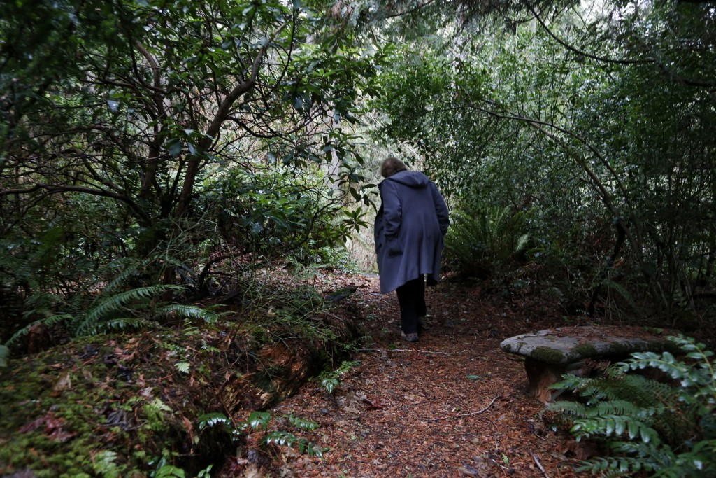 In this Monday, Dec. 10, 2018, photo, Psychologist Hilarie Cash walks on a forest path at a rehab center for adolescents in a rural area outside Redmo...