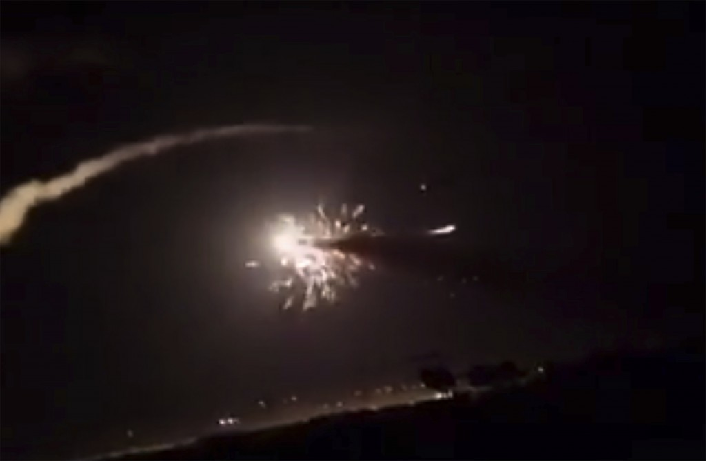 This frame grab from a video provided by the Syrian official news agency SANA shows missiles flying into the sky near Damascus, Syria, Tuesday, Dec. 2