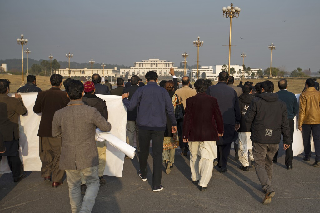 In this Thursday, Dec. 20, 2018 photo, jobless newspaper workers march towards the Parliament in Islamabad, Pakistan. Journalists and press freedom ad...