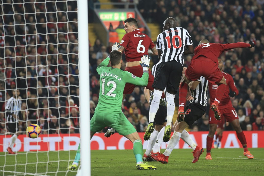 Liverpool's Fabinho, right, scores his side's fourth goal during the English Premier League soccer match between Liverpool and Newcastle at Anfield St...