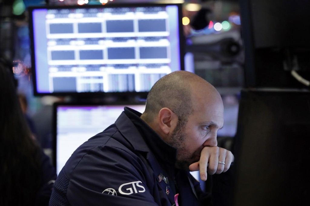 Specialist James Denaro works on the floor of the New York Stock Exchange, Wednesday, Dec. 26, 2018. Stocks are opening strongly higher on Wall Street...