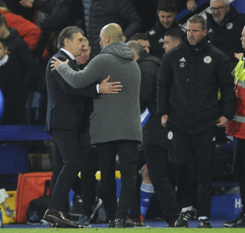 Leicester manager Claude Puel, left, and Manchester City manager Josep Guardiola shake hands after the English Premier League soccer match between Lei