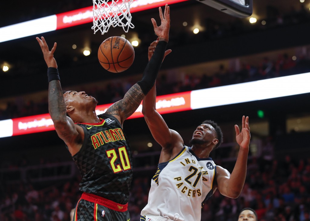 Indiana Pacers forward Thaddeus Young (21) competes for a rebound with Atlanta Hawks forward John Collins (20) during the second half of an NBA basket...