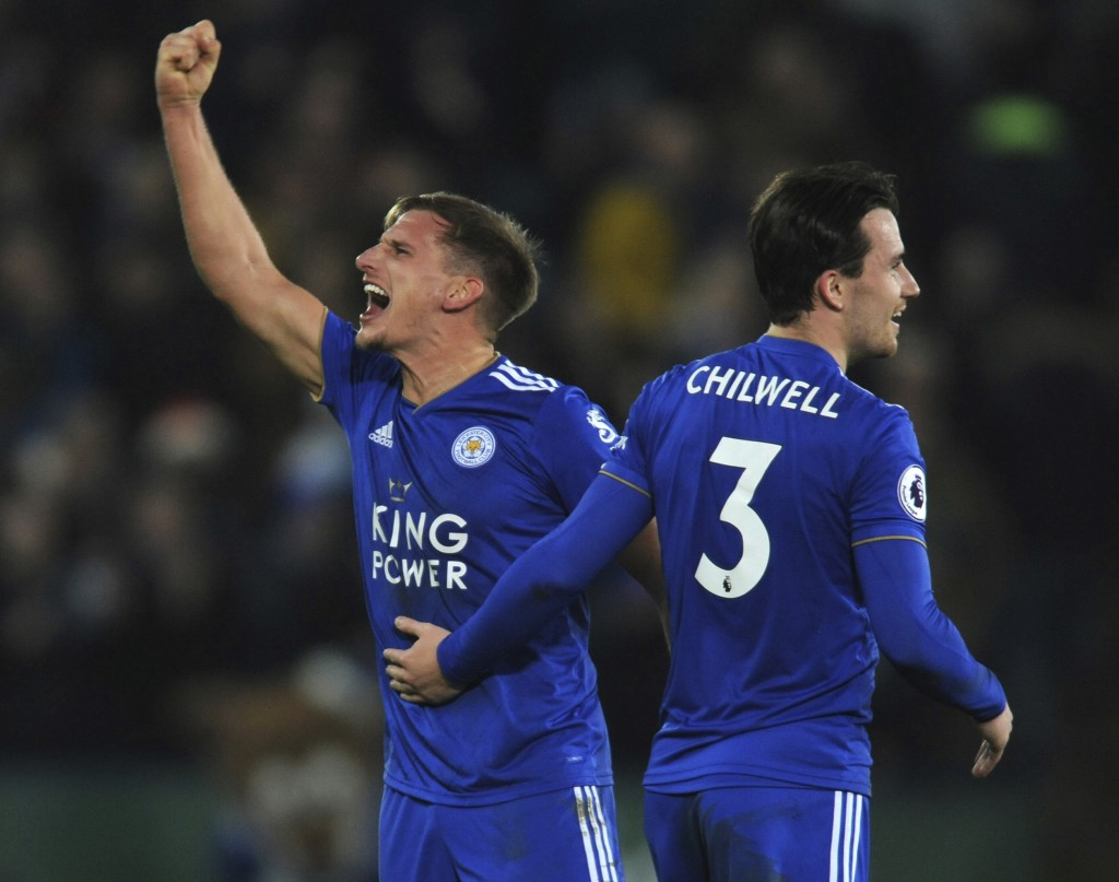 Leicester's Marc Albrighton, left, and Leicester's Ben Chilwell celebrate their victory during the English Premier League soccer match between Leicest
