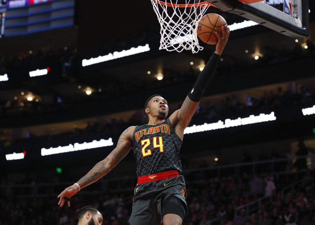Atlanta Hawks guard Kent Bazemore (24) goes up for a layup in the first half of an NBA basketball game against the Indiana Pacers on Wednesday, Dec. 2...