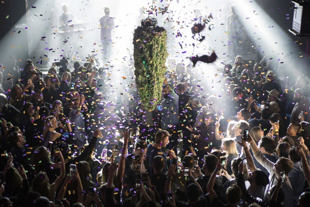 FILE - In this Oct. 17, 2018, file photo a depiction of a cannabis bud drops from the ceiling at Leafly's countdown party in Toronto as midnight passe...