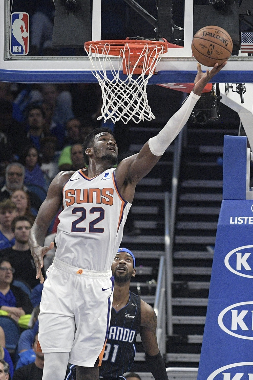 Phoenix Suns center Deandre Ayton (22) goes up for a shot in front of Orlando Magic guard Terrence Ross (31) during the second half of an NBA basketba...