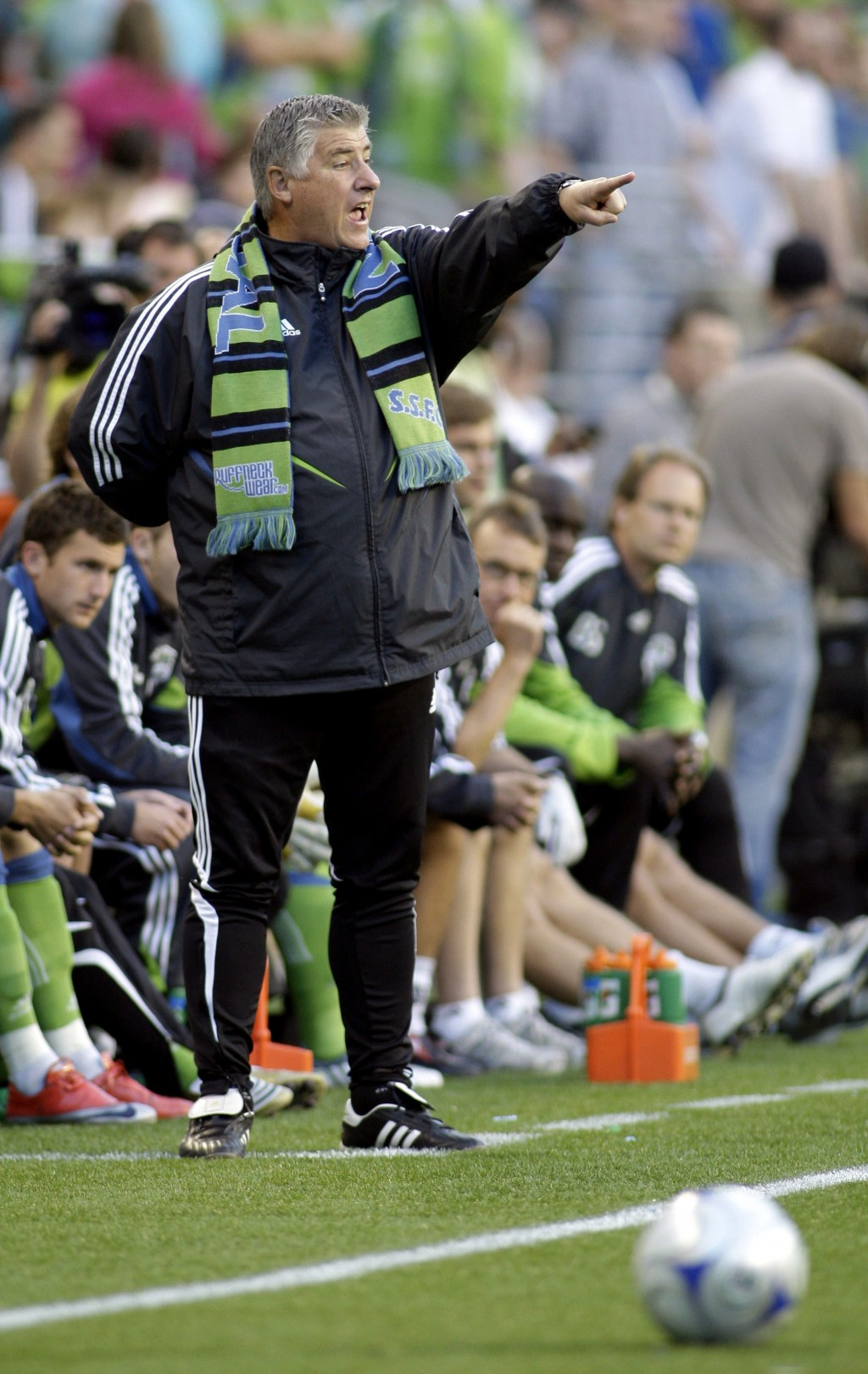 FILE - In this May 30, 2009, file photo, Seattle Sounders coach Sigi Schmid gestures from the sideline during the first half against the Columbus Crew