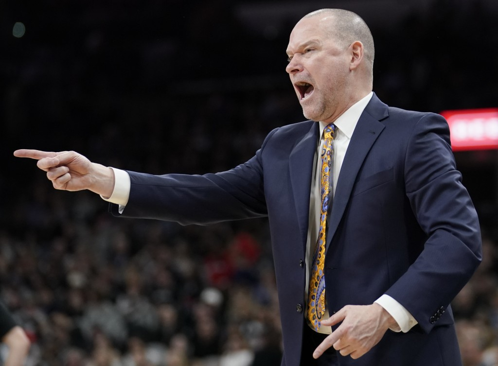 Denver Nuggets coach Michael Malone yells to his players during the second half of the team's NBA basketball game against the San Antonio Spurs, Wedne...