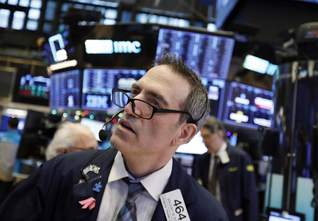 Trader Gregory Rowe works on the floor of the New York Stock Exchange, Wednesday, Dec. 26, 2018. Stocks are opening strongly higher on Wall Street Wed...