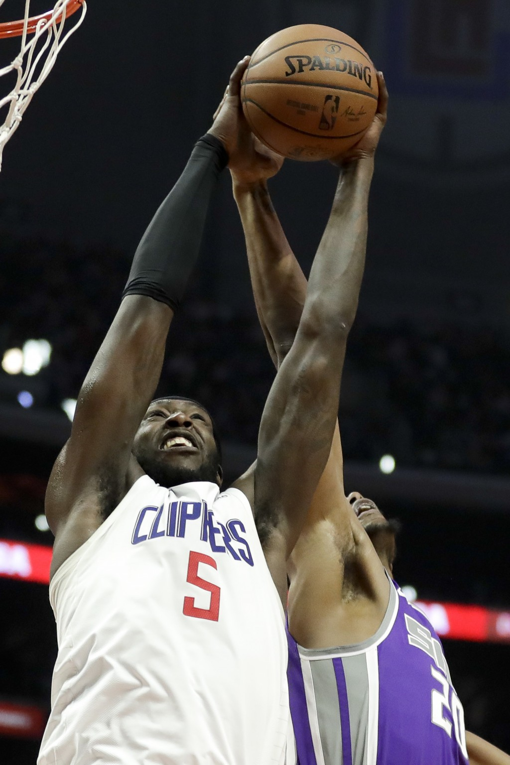 Los Angeles Clippers forward Montrezl Harrell (5) pulls a rebound away from Sacramento Kings forward Harry Giles during the second half of an NBA bask...