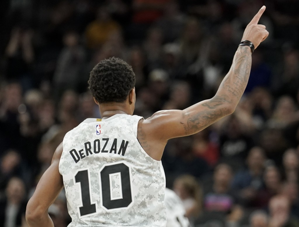 San Antonio Spurs' DeMar DeRozan celebrates a basket during the second half of the team's NBA basketball game against the Denver Nuggets, Wednesday, D...