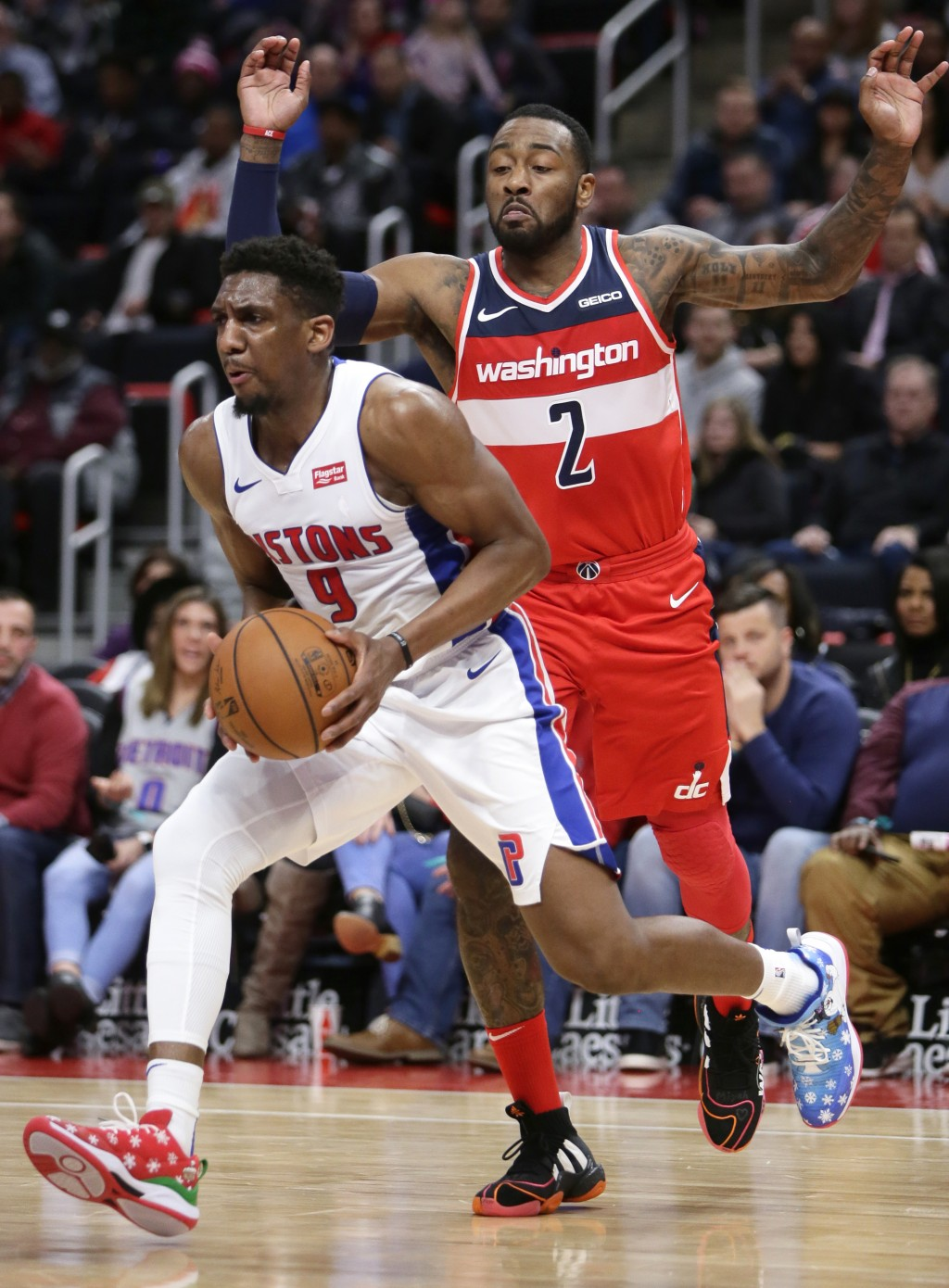 Detroit Pistons guard Langston Galloway (9) drives to the basket past Washington Wizards guard John Wall (2) during the first half of an NBA basketbal