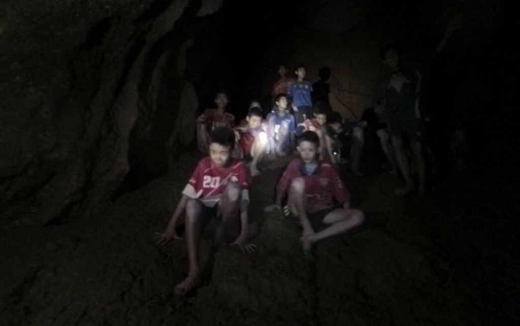 This Monday, July 2, 2018, file photo released by Tham Luang Rescue Operation Center, shows the boys and their soccer coach as they were found in a pa...