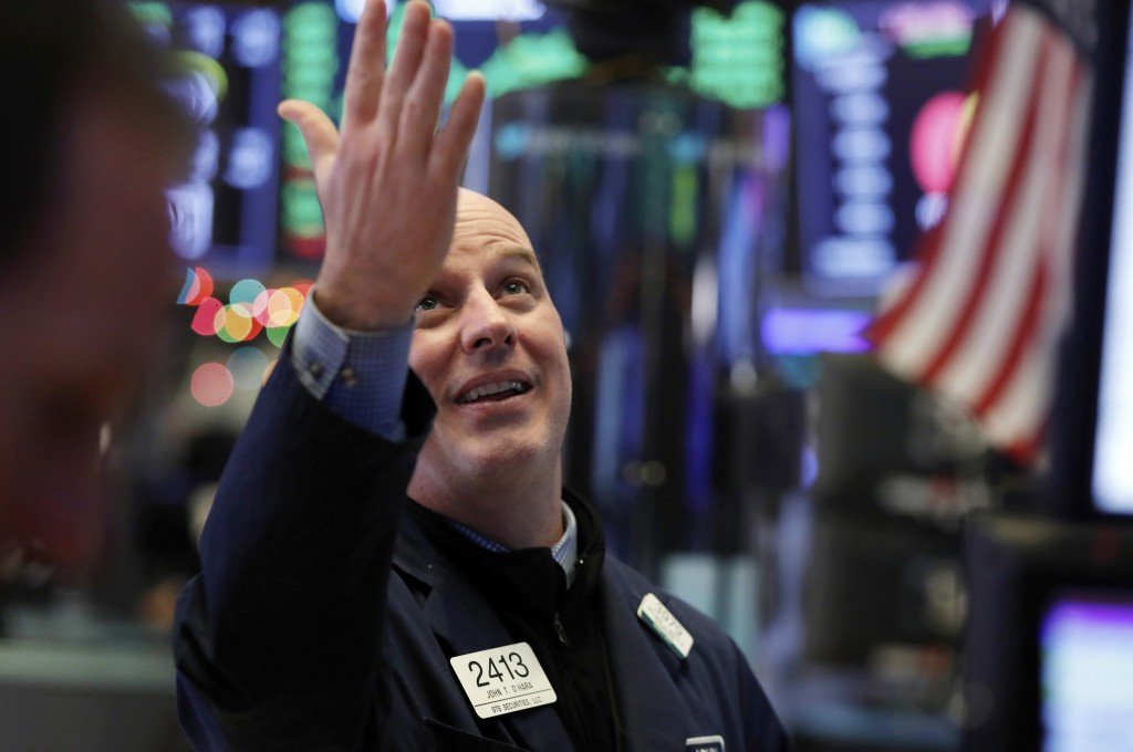 Specialist John O''Hara gestures as he looks at the Dow Jones industrial average before the closing bell on the floor of the New York Stock Exchange, ...
