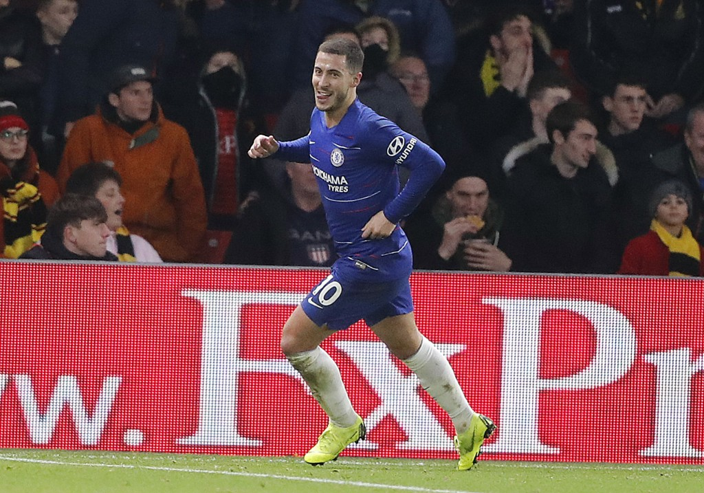 Chelsea's Eden Hazard, celebrates after scoring form penalty his side second goal during the English Premier League soccer match between Watford and C...