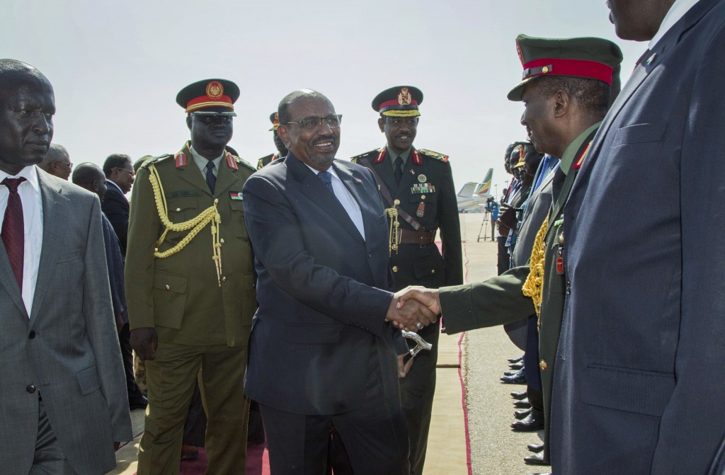 FILE - In this Oct. 31, 2018 file photo, Sudan's President Omar Bashir, center, greets dignitaries as he arrives at the airport in Juba, South Sudan. ...
