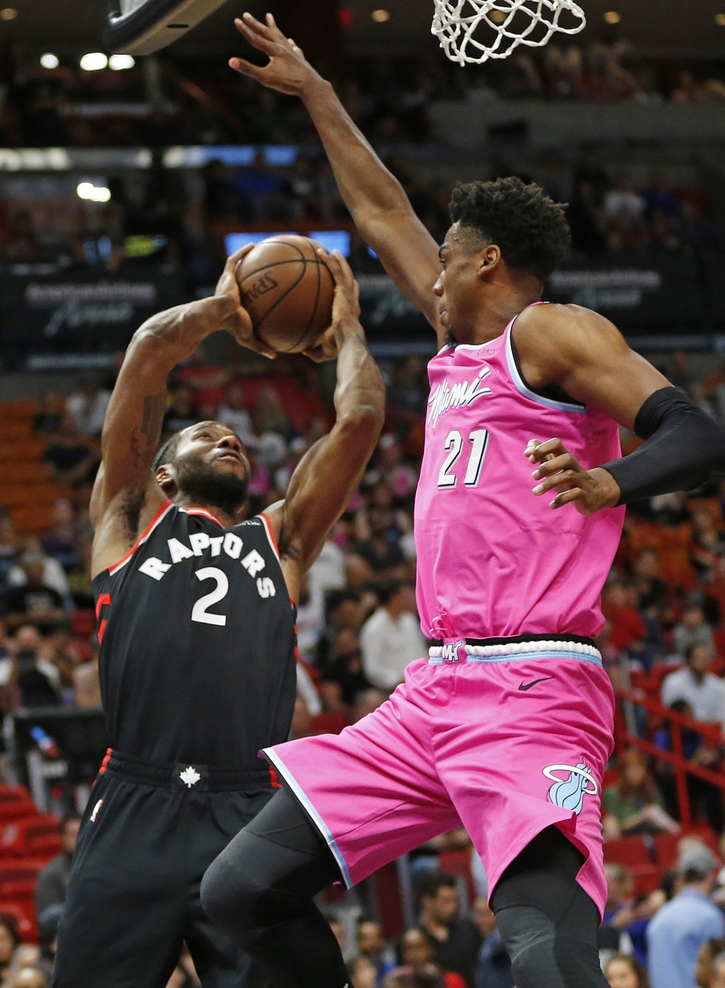 Miami Heat center Hassan Whiteside (21) defends against Toronto Raptors forward Kawhi Leonard (2) as he shoots the ball during the first half of an NB...
