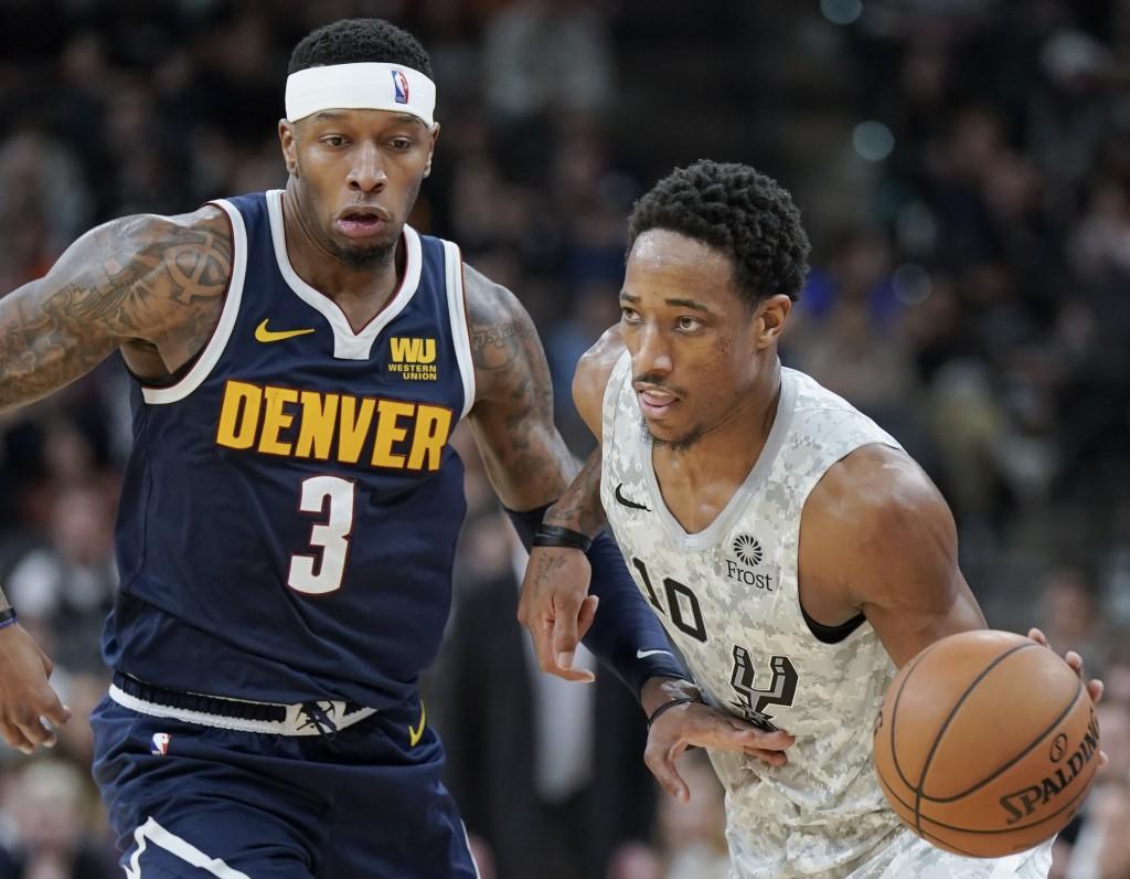 San Antonio Spurs' DeMar DeRozan (10) drives around Denver Nuggets' Torrey Craig during the second half of an NBA basketball game Wednesday, Dec. 26, ...