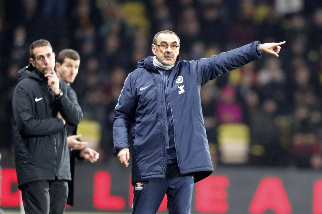 Chelsea's team manager Maurizio Sarri, center, gives instructions during the English Premier League soccer match between Watford and Chelsea at Vicara