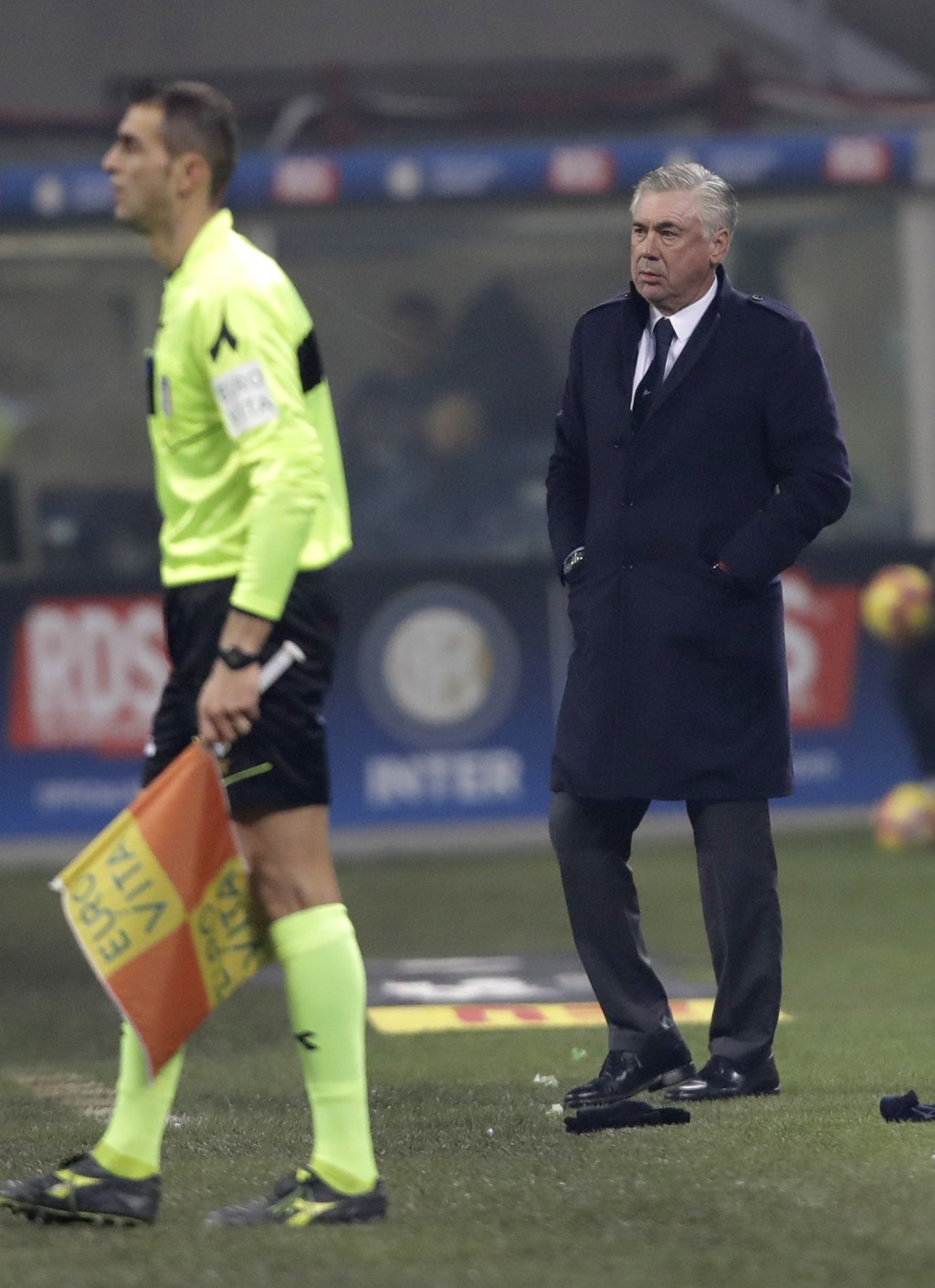 Napoli coach Carlo Ancelotti stands during a Serie A soccer match between Inter Milan and Napoli, at the San Siro stadium in Milan, Italy, Wednesday,