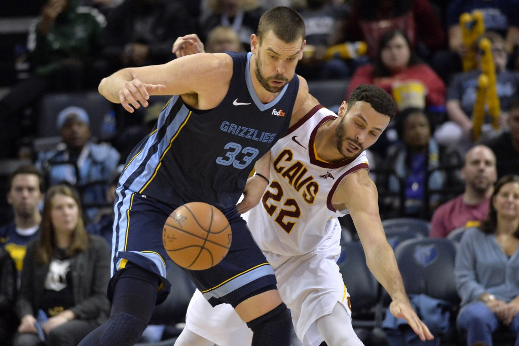 Memphis Grizzlies center Marc Gasol (33) and Cleveland Cavaliers forward Larry Nance Jr. (22) struggle for control of the ball during the second half ...