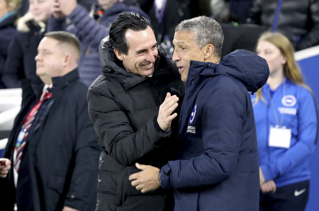 Arsenal manager Unai Emery, left, and Brighton & Hove Albion manager Chris Hughton prior to their English Premier League soccer match at the AMEX Stad...