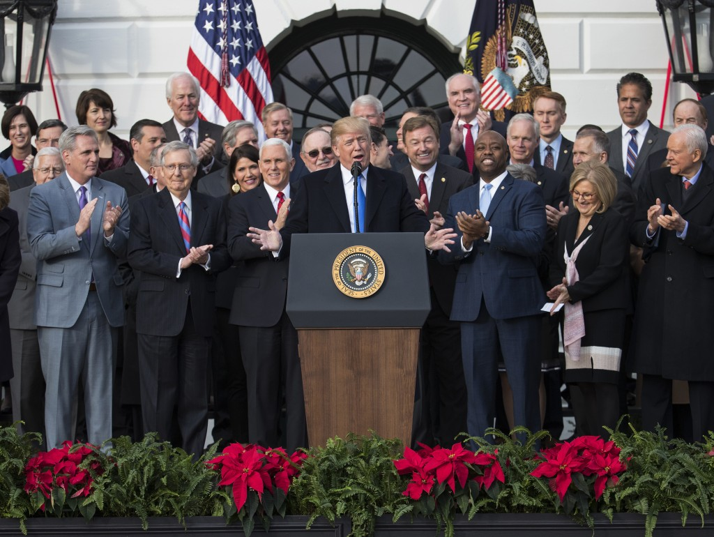 FILE - In this Dec. 20, 2017, file photo, President Donald Trump speaks during an event on the South Lawn of the White House in Washington, to acknowl...