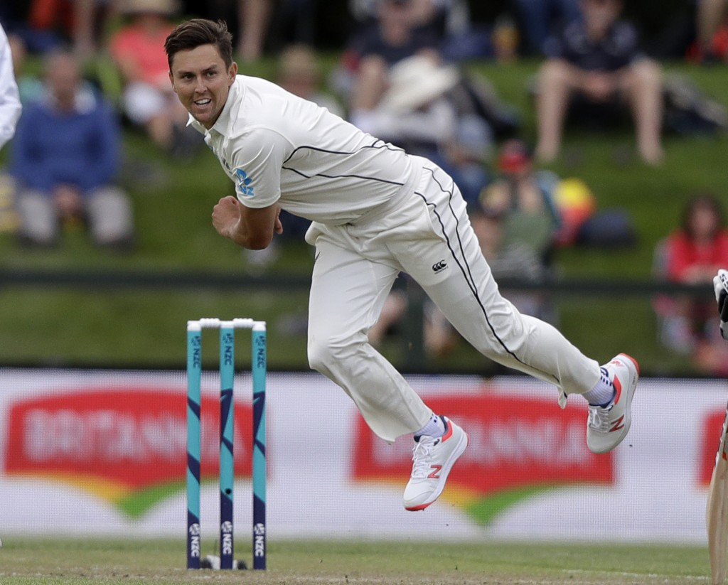 New Zealand's Trent Boult bowls during play on day two of the second cricket test between New Zealand and Sri Lanka at Hagley Oval in Christchurch, Ne...
