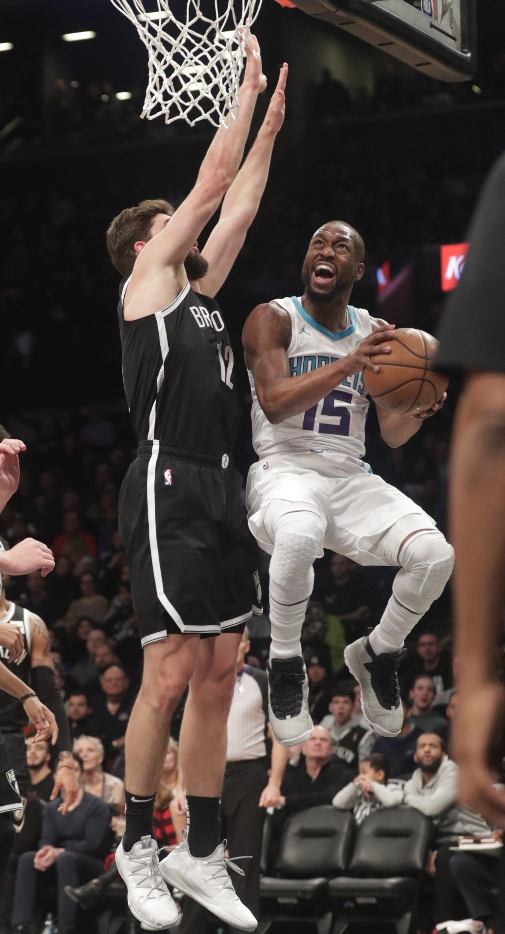 Charlotte Hornets' Kemba Walker, right, drives past Brooklyn Nets' Joe Harris during the first half of an NBA basketball game Wednesday, Dec. 26, 2018...