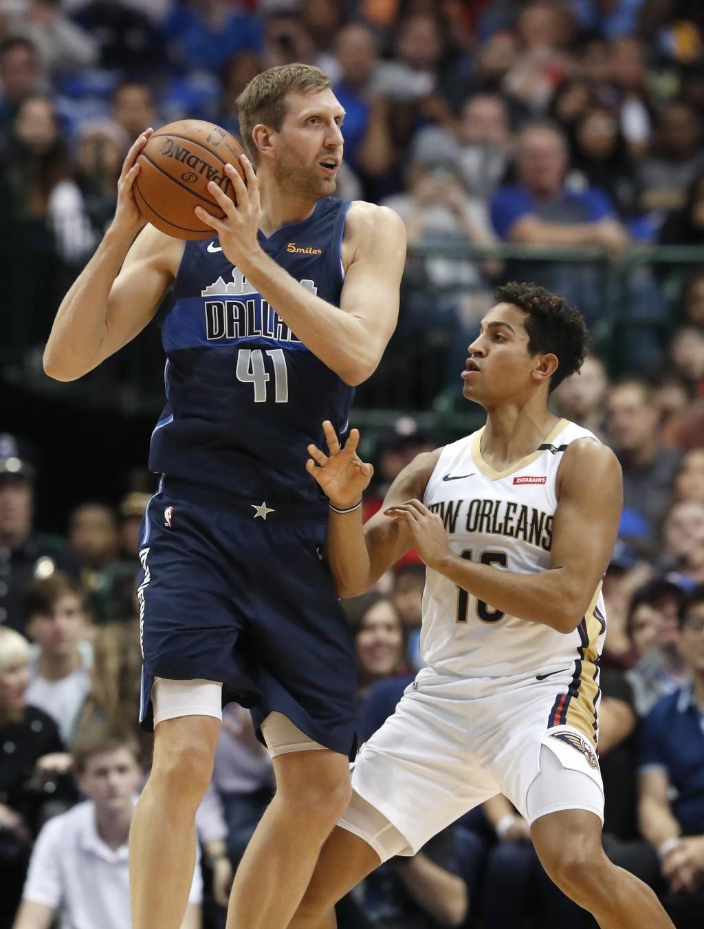 Dallas Mavericks forward Dirk Nowitzki (41) keeps the ball from New Orleans Pelicans guard Frank Jackson during the first half of an NBA basketball ga...