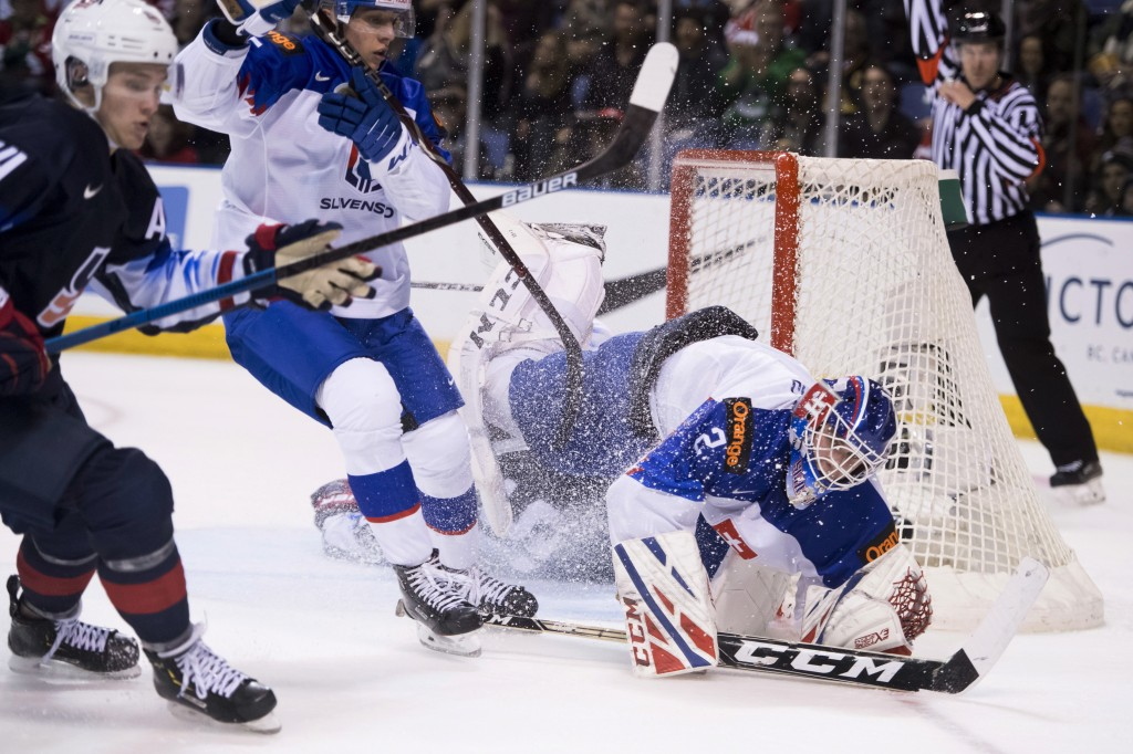 CORRECTS CITY TO VICTORIA, INSTEAD OF VANCOUVER - United States' Jason Robertson crashes into Slovakia goaltender Samuel Hlavaj during the second peri