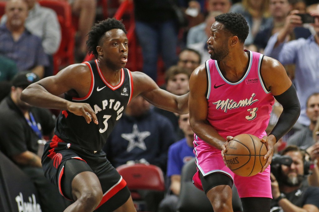 Toronto Raptors forward OG Anunoby (3) defends against Miami Heat guard Dwyane Wade (3) during the first half of an NBA basketball game, Wednesday, De...