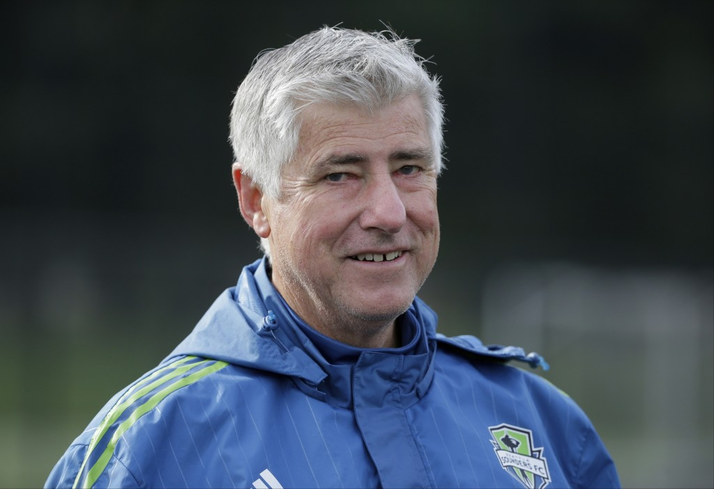 FILE - In this Oct. 27, 2015, file photo, Seattle Sounders coach Sigi Schmid walks off the field following an MLS soccer training session in Tukwila,