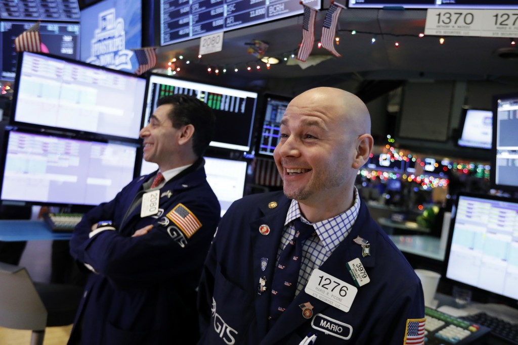 Specialists Peter Mazza, left, and Mario Picone work on the floor of the New York Stock Exchange, Wednesday, Dec. 26, 2018. Stocks are opening strongl...