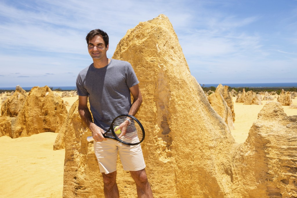 Swiss tennis player Roger Federer poses for a photograph during a media event at the Pinnacles in Nambung National Park, Western Australia Thursday, D...