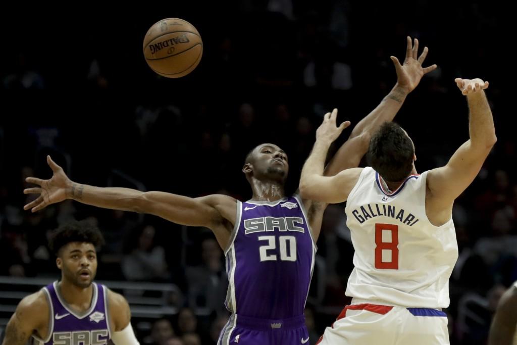 Sacramento Kings forward Harry Giles (20) blocks a shot by Los Angeles Clippers forward Danilo Gallinari during the second half of an NBA basketball g...