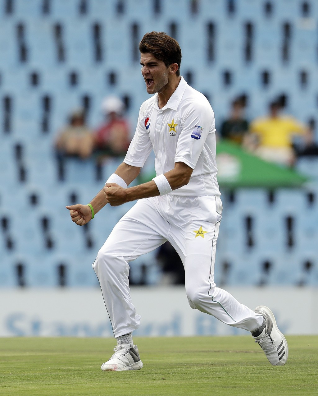 Pakistan's bowler Shaheen Afridi celebrates after dismissing South Africa's batsman Temba Bavuma for 53 runs on day two of the first cricket test matc...