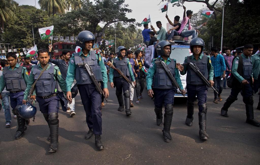 Bangladeshi policemen escort Bangladesh Awami League party election rally in Dhaka, Bangladesh, Thursday, Dec. 27, 2018. Bangladesh heads for the 11th...