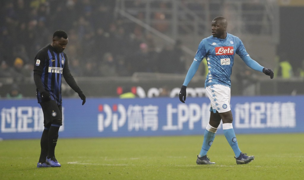 In this image taken on Wednesday, Dec.26, Napoli's Kalidou Koulibaly, right, leaves the pitch after receiving a red card from the referee during a Ser...