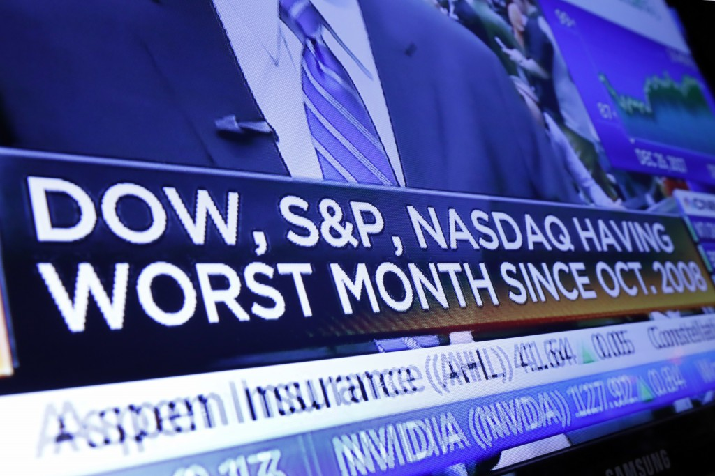 A headline appears on a television screen on the floor of the New York Stock Exchange, Wednesday, Dec. 26, 2018. Stocks are opening strongly higher on...