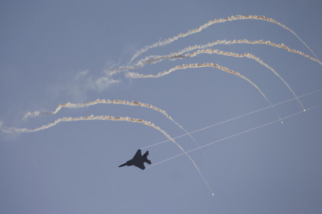 Israeli Air Force F-15 plane flies during a graduation ceremony for new pilots in Hatzerim air force base near the southern Israeli city of Beersheba,...