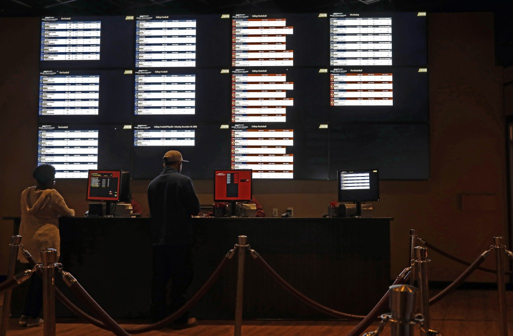 In this Dec. 18, 2018 photo, patrons place their wages at the Pearl River Resort, in Philadelphia, Miss. The sports book owned by the Mississippi Band