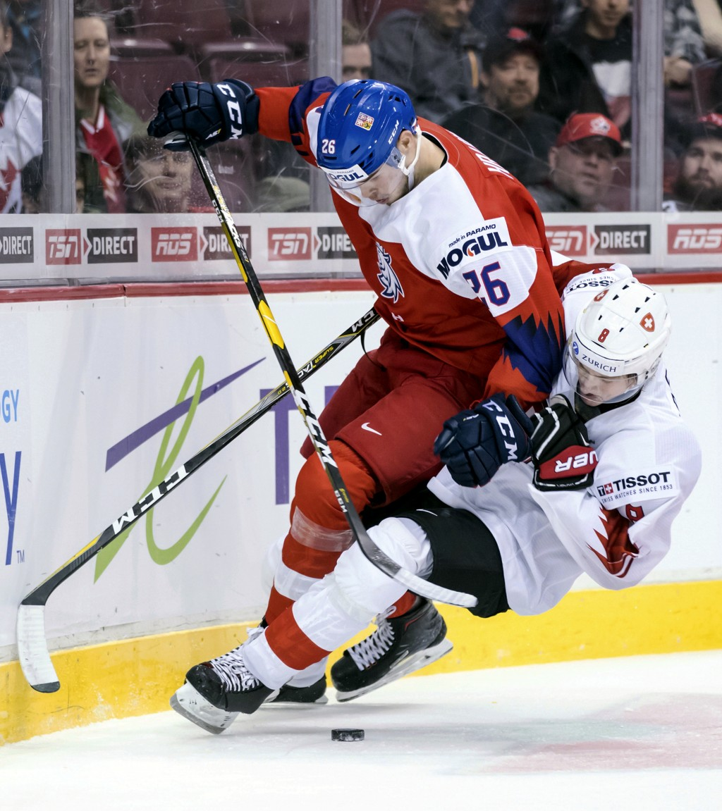 Czech Republic's Krystof Hrabik (26) and Switzerland's Janis Moser collide (8) during second period World Junior Hockey Championship action in Vancouv